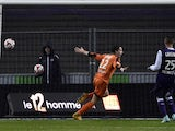 Lorient's French forward Benjamin Jeannot celebrates after scoring a goal during the French L1 football match Toulouse vs Lorient on November 29, 2014