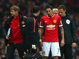 Injured Angel di Maria of Manchester United receives treatment during the Barclays Premier League match between Manchester United and Hull City at Old Trafford on November 29, 2014