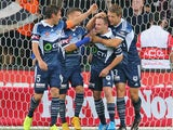 Leigh Broxham of the Victory is congratulated by his teammates after scoring a goal during the round eight A-League match between Melbourne Victory and Adelaide United at AAMI Park on November 28, 2014