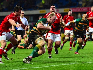 Saints player Ben Nutley crosses for a Saints try during the Aviva Premiership match between London Welsh and Northampton Saints at Kassam Stadium on November 30, 2014