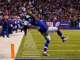 Odell Beckham #13 of the New York Giants scores a touchdown in the second quarter against the Dallas Cowboys at MetLife Stadium on November 23, 2014