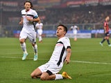 Paulo Dybala of Palermo celebrates after scoring the opening goal during the Serie A match between Genoa CFC and US Citta di Palermo at Stadio Luigi Ferraris on November 24, 2014