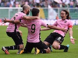 Paulo Dybala of Palermo celebrates with Enzo Maresca and Edgar Barreto after scoring the opening goal during the Serie A match between US Citta di Palermo and Parma FC at Stadio Renzo Barbera on November 30, 2014
