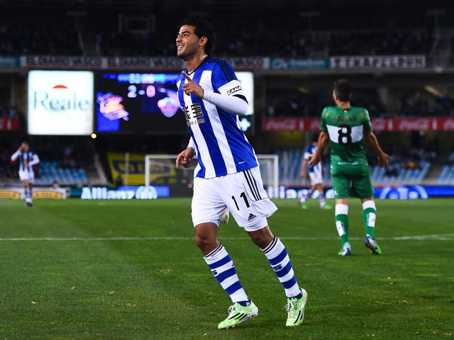 Carlos Vela Garrido of Real Sociedad celebrates after scoring his team's third goal during the La Liga match between Real Socided and Elche FC at Estadio Anoeta on November 28, 2014