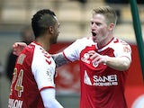 Reims' French forward Gaetan Charbonnier congratulates Reims' French forward David Ngog after he scored a goal during the French L1 football match Reims vs Bastia on November 29, 2014