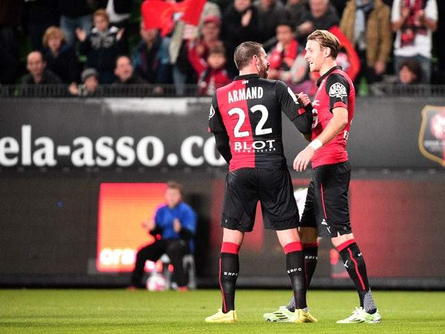 Rennes' Swedish forward Ola Toivonen celebrates with Rennes' French defender Sylvain Armand after scoring a goal during the French L1 football match Rennes against Monaco on November 29, 2014