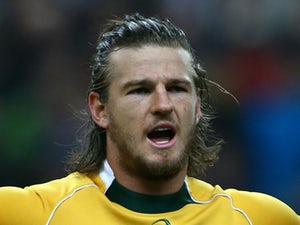 Rob Horne of Australia sings the national anthem during the International match between France and Australia at The Stade De France on November 15, 2014
