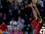 AS Roma's forward Gervinho of Ivory Coast celebrates after scoring against InterMilan during the Italian Serie A football match between AS Roma and Inter Milan at the Olympic stadium on November 30, 2014