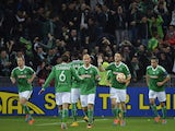 Saint-Etienne's Dutch forward Ricky Van Wolfswinkel celebrates with his teamates after scoring an equalizer during the UEFA Europa League Group F football match AS Saint-Etienne (ASSE) vs FK Qarabag Agdam on November 27, 2014