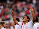 Sevilla's Colombian forward Carlos Bacca celebrates after scoring during the Spanish league football match Sevilla FC vs Granada FC at the Ramon Sanchez Pizjuan stadium in Sevilla on November 30, 2014