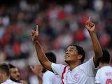 Sevilla's Colombian forward Carlos Bacca celebrates after scoring during the Spanish league football match Sevilla FC vs Granada FC at the Ramon Sanchez Pizjuan stadium in Sevilla on November 30, 2014