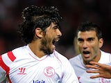 Sevilla's Argentinian midfielder Ever Banega celebrates after scoring during the Spanish league football match Sevilla FC vs Granada FC at the Ramon Sanchez Pizjuan stadium in Sevilla on November 30, 2014