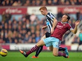 West Ham United's English midfielder Mark Noble vies with Newcastle United's English midfielder Jack Colback during the English Premier League football match between West Ham United and Newcastle United at the Boleyn Ground, Upton Park, in east London on