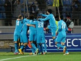 Zenit's players celebrate their goal during the UEFA Champions league group C football match against Benfica in St. Petersburg on November 26, 2014