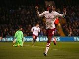 Christian Benteke of Aston Villa celebrates scoring his team's first goal during the Barclays Premier League match between Crystal Palace and Aston Villa at Selhurst Park on December 2, 2014