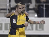 Atletico Madrid's French midfielder Antoine Griezmann celebrates after scoring during the Spanish Copa del Rey (King's Cup) round of 32 first leg football match CE L'Hospitalet vs Club Atletico de Madrid at the Feixa Llarga stadium in L'Hospitalet de Llob