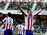 Atletico Madrid's Uruguayan defender Jose Maria Gimenez celebrates after scoring during the Spanish league football match Elche FC vs Club Atletico Madrid at the Martin Valero stadium in Valencia on December 6, 2014
