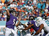 Quarterback Joe Flacco #5 of the Baltimore Ravens throws against the Miami Dolphins in the first quarter during a game at Sun Life Stadium on December 7, 2014