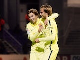 Barcelona's Croatian midfielder Ivan Rakitic celebrates with his teammate midfielder Sergi Samper after scoring during the Spanish Copa del Rey (King's Cup) round of 32 first leg football match S.A.D. Huesca vs FC Barcelona at El Alcoraz stadium in Huesca