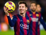 Lionel Messi of FC Barcelona with the match ball after scoring three goals during the La Liga match between FC Barcelona and RCD Espanyol at Camp Nou on December 7, 2014