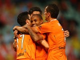 Henrique of the Roar celebrates with team mates after scoring a goal during the round four A-League match between the Western Sydney Wanderers and Brisbane Roar at Pirtek Stadium on December 3, 2014