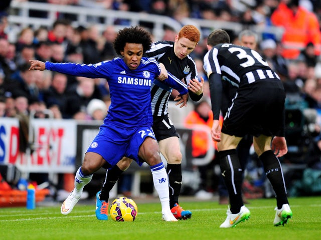 Jack Colback of Newcastle challenges Willian of Chelsea during the Barclays Premier League match between Newcastle United and Chelsea at St James' Park on December 6, 2014