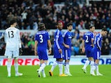 Despondent Chelsea players look on as their unbeaten record in 2014-15 ends against Newcastle United in the Premier League on December 6, 2014