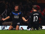 Darron Gibson of Manchester United celebrates with team mate Wayne Rooney (10) as he scores their second goal during the Barclays Premier League match against West Ham on December 5, 2014