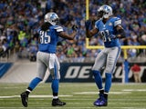 Joique Bell #35 and Calvin Johnson #81 of the Detroit Lions celebrate a second quarter touchdown while playing the Tampa Bay Buccaneers at Ford Field on December 07, 2014