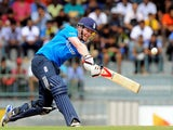 :England cricketer Eoin Morgan plays a shot during the fourth One Day International (ODI) match between Sri Lanka and England at the R. Premadasa Cricket Stadium in Colombo on December 7, 2014