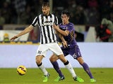 Stefan Savic of ACF Fiorentina fights for the ball with Fernando Llorente of Juventus FC during the Serie A match on December 5, 2014