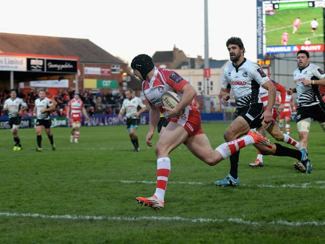 Stevie McColl of Gloucester Rugby runs in to score a try during the European Rugby Challenge Cup match between Gloucester Rugby and Zebre at Kingsholm Stadium on December 7, 2014