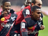 Guingamp's French midfielder Claudio Beauvue celebrates with teammates after scoring the ball during the French L1 football match EA Guingamp vs Stade Malherbe Caen on December 3, 2014