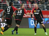 Guingamp's Danish defender Lars Jacobsen celebrates after scoring a goal during the French L1 football match Stade de Reims vs Guingamp at Auguste Delaune Stadium in Reims on December 7, 2014