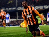Hull City's Nigerian midfielder Sone Aluko celebrates scoring their first goal during the English Premier League football match between Everton and Hull City at Goodison Park in Liverpool, north west England on December 3, 2014