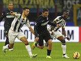 Mateo Kovacic of FC Internazionale Milano competes for the ball with Bruno Borges Fernandes and Babu Emmanuel Agyemang (R) of Udinese Calcio during the Serie A match between FC Internazionale Milano and Udinese Calcio at Stadio Giuseppe Meazza on December