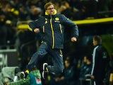 Dortmund's head coach Juergen Klopp celebrates after Dortmund's midfielder Ilkay Guendogan scored the 1-0 goal during the German first division Bundesliga football match on December 5, 2014