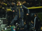 Dortmund's head coach Juergen Klopp celebrates after Dortmund's midfielder Ilkay Guendogan scored the 1-0 goal during the German first division Bundesliga football match on December 5, 2014