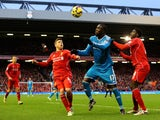 Jozy Altidore of Sunderland battles for the ball with Kolo Toure and Alberto Moreno of Liverpool during the Barclays Premier League match on December 6, 2014
