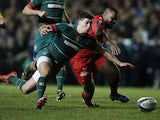 Leicester's English scrum half Ben Youngs is tackled by Toulon's French centre Mathieu Bastareaud in the European Champions Cup rugby union match between Leicester Tigers and Toulon at Welford Road stadium in Leicester, central England on December 7, 2014