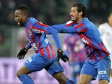 Caen's French forward Lenny Nangis (L) celebrates with a teammate after scoring a goal during the French L1 football match against Nice on December 6, 2014