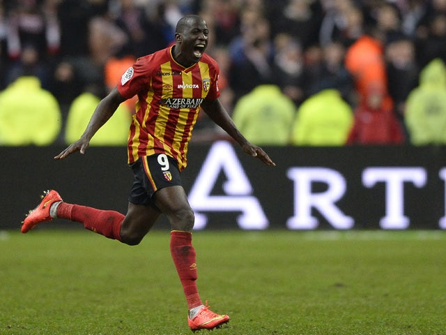 Lens' French forward Adamo Coulibaly celebrates after scoring a goal during the French L1 football match between Lens and Lille at the Stade de France in Saint-Denis, north of Paris, on December 7, 2014