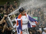 Lewis Hamilton of Great Britain and Mercedes celebrates after winning the Formula 1 World Championship at the Abu Dhabi Grand Prix on November 23, 2014
