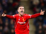 Jordan Henderson of Liverpool celebrates after scoring his team's third goal during the Barclays Premier League match between Leicester City and Liverpool at The King Power Stadium on December 2, 2014
