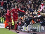 Liverpool's Peter Crouch celebrates after soring his first goal against Wigan during their Premiership match at Anfield, in Liverpool, 03 December 2005