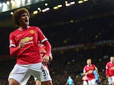 Manchester United's Belgian midfielder Marouane Fellaini celebrates after scoring the opening goal of the English Premier League football match between Manchester United and Stoke City at Old Trafford in Manchester, north west England, on December 2, 2014