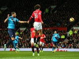Marouane Fellaini of Manchester United scores the first goal during the Barclays Premier League match between Manchester United and Stoke City at Old Trafford on December 2, 2014