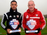 Brentford's Mark Warburton and Andre Gray with their Manager and Player of the Month awards for November on December 4, 2014