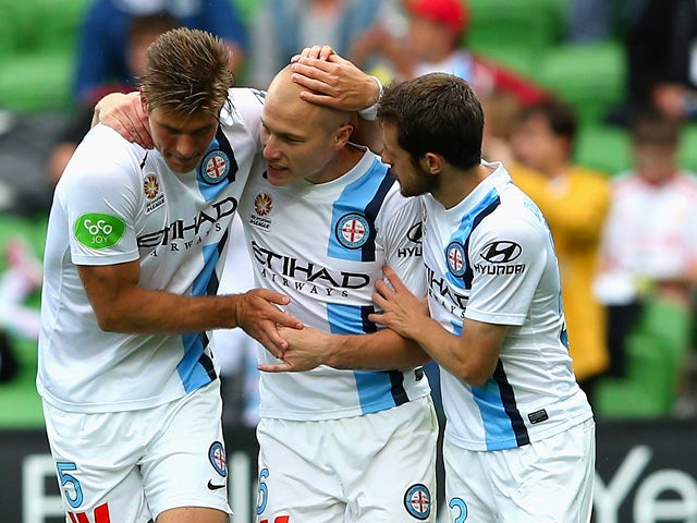 Aaron Mooy of City is congratulated by team mates after scoring a goal during the round 10 A-League match between Melbourne City FC and Brisbane Roar at AAMI Park on December 7, 2014