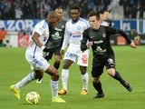 Metz's forward Federico Andrada vies with Marseille's French defender Rod Fanni during the French L1 football match between Marseille and Metz at the Velodrome stadium in Marseille on December 7, 2014